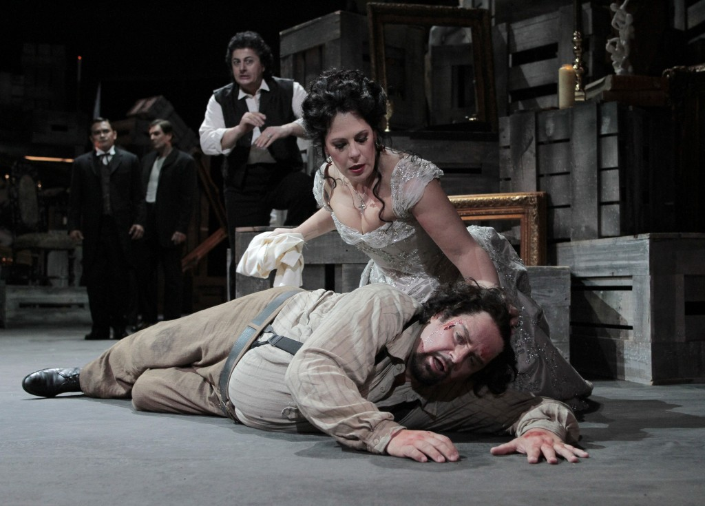 Sondra Radvanovsky as Tosca and Marco Berti as Cavaradossi, with Lado Ataneli as Scarpia. Photo: Robert Millard