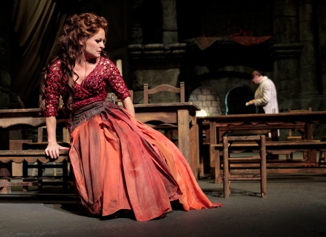 Patricia Bardon as Carmen. In distance, Brandon Jovanovich as Don José. Photo by Robert Millard.