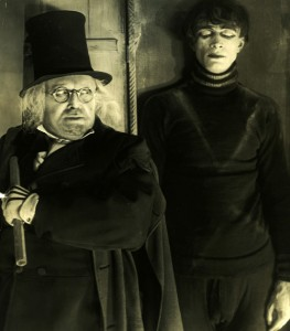 "Werner Krauss and Conrad Veidt in ""The Cabinet of Dr. Caligari."" Note the stove-pipe hat."