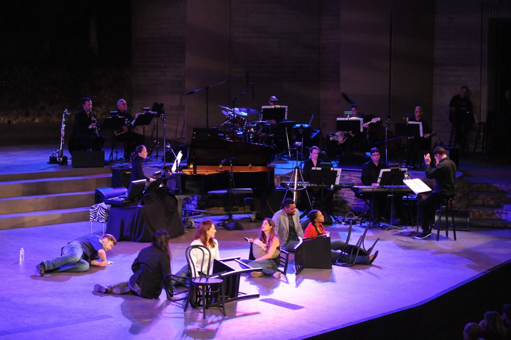 Some cast members and the band conducted by Andreas Mitisek. Photo by Keith Ian Polakoff.